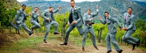 Groomsmen jumping silly before wedding ceremony0f51